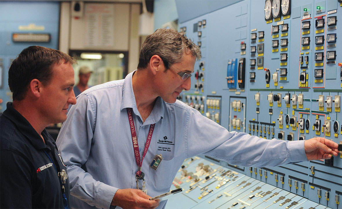 A CNSC inspector and a worker from NB Power at the Point Lepreau Nuclear Generating Station, New Brunswick